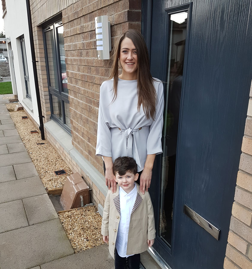 Brooke with her son outside their home