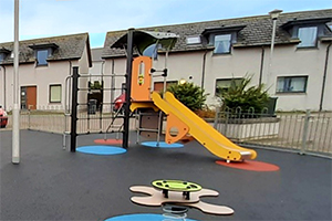 The yellow and orange slide at the Portsoy children's playground