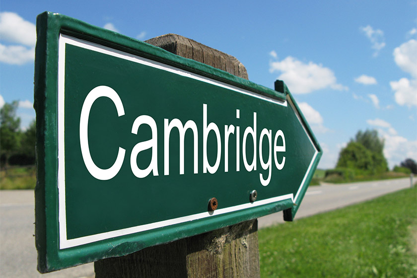 Close up of a road sign pointing to Cambridge