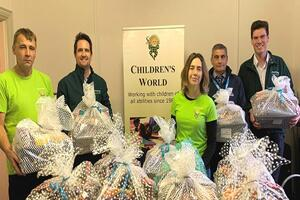 Staff show the Christmas hampers donated to families in Glastonbury