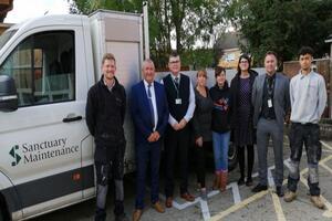 Sanctuary staff posing in front of van