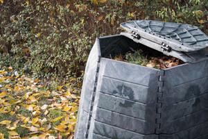 A grey garden compost bin