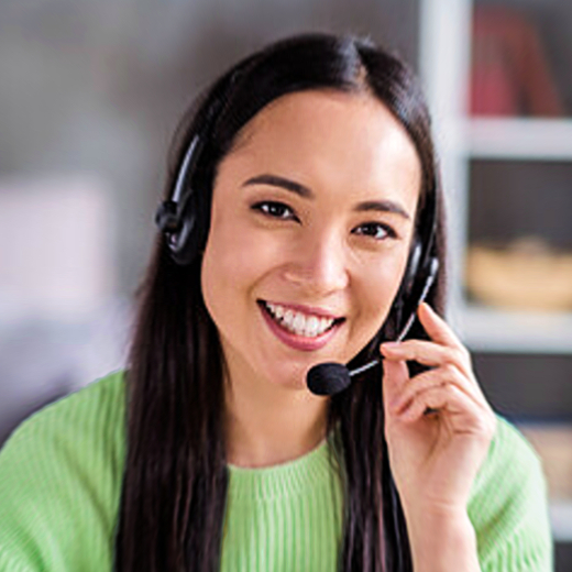 A happy lady wearing a telephone headset