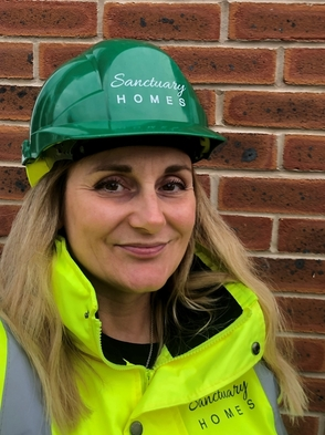 Karen Thorley wearing Sanctuary Homes protective gear