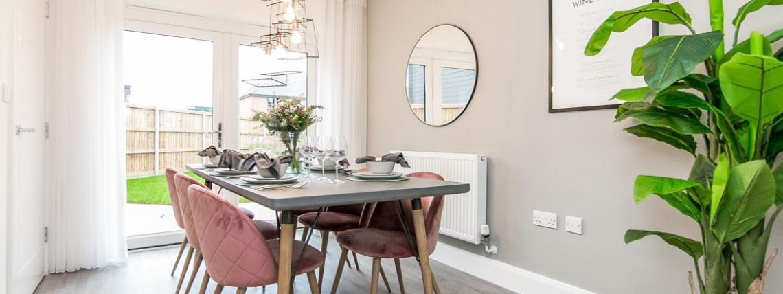 A furnished dining room at a Penny Fields' show home