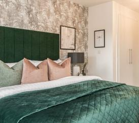 A beautifully furnished bedroom at a Penny Fields' show home