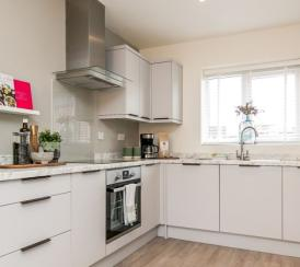 A brightly furnished kitchen at a Penny Fields' show home