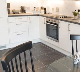 Quadrangle kitchen and dining area duplex apartments