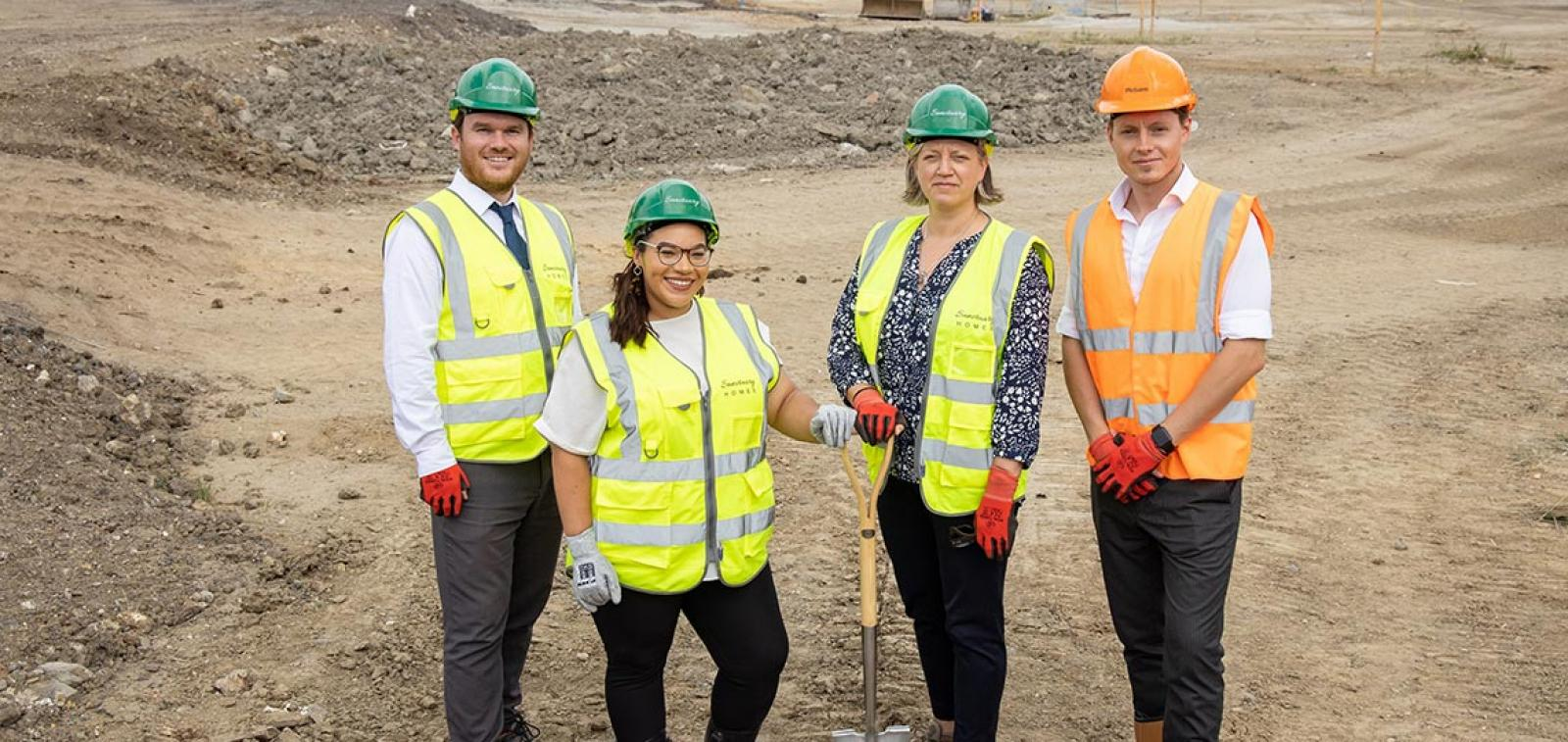 Sanctuary Homes staff stand on the building side of the new Sittingbourne development