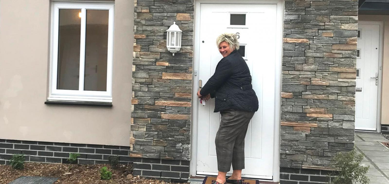Sharon outside her new Shared Ownership home