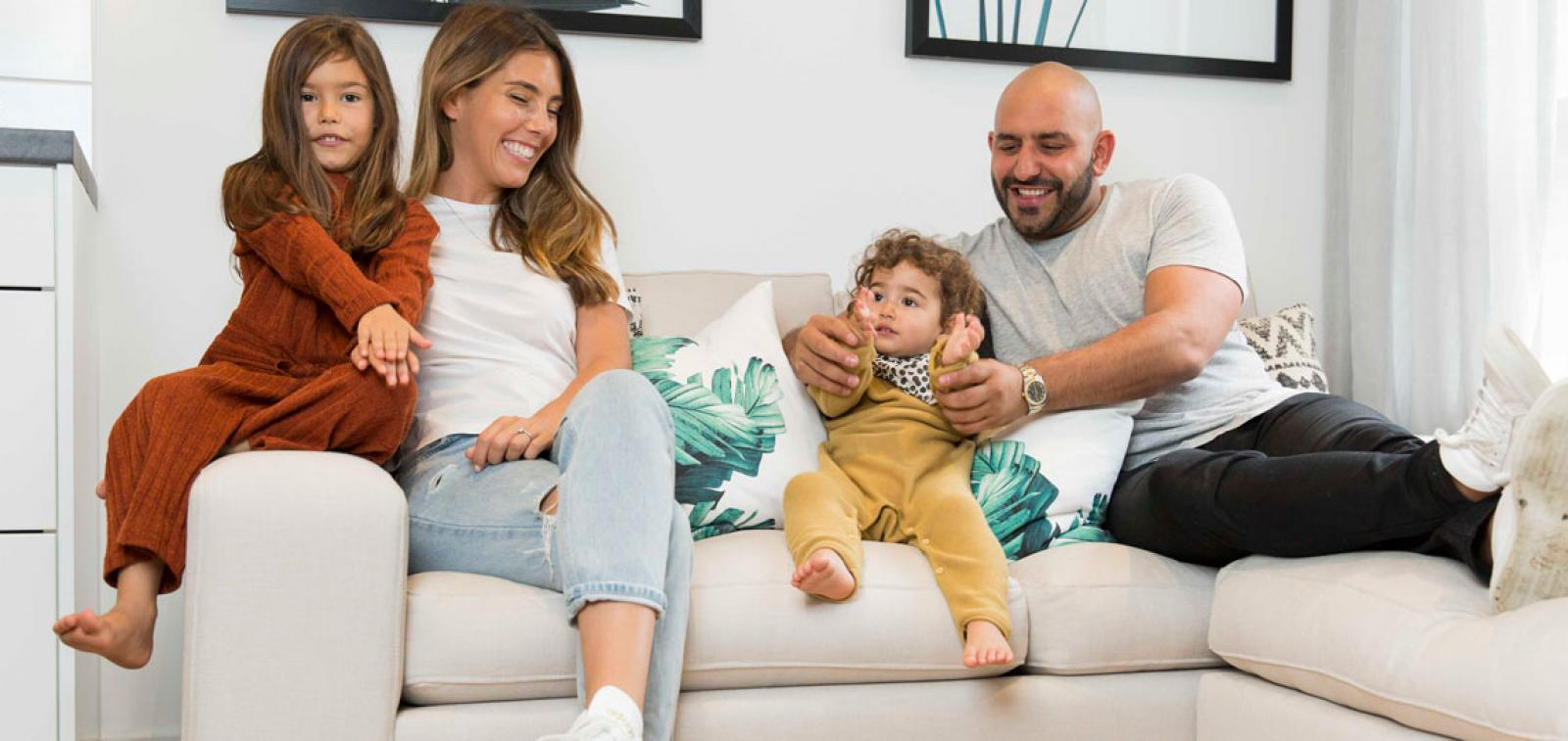 A family enjoying their new shared ownership home.