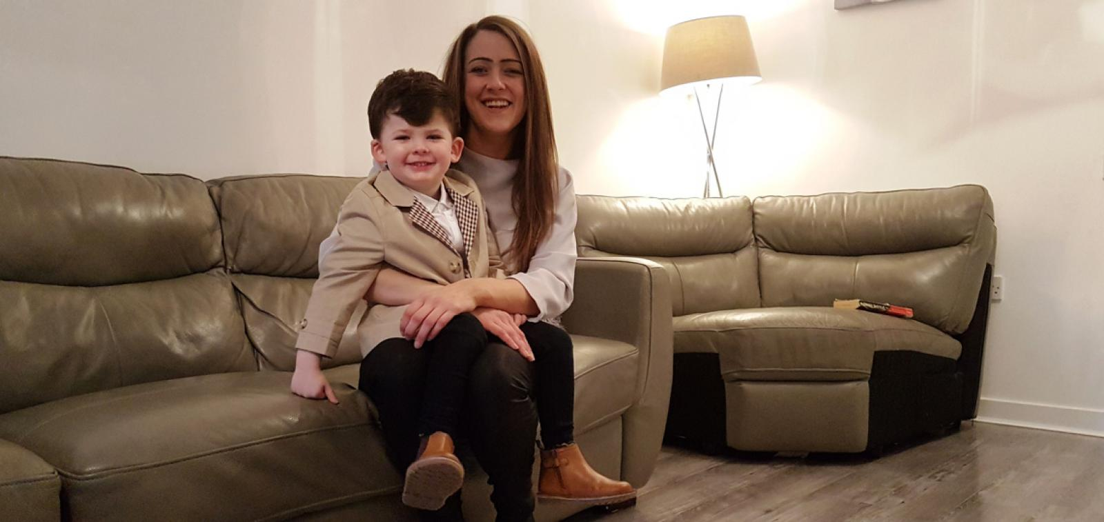 Brooke and her son within their home