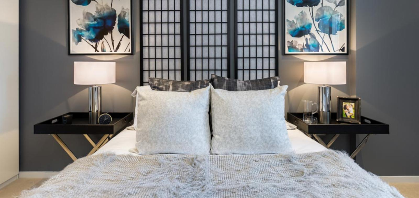 White bed with bedside tables