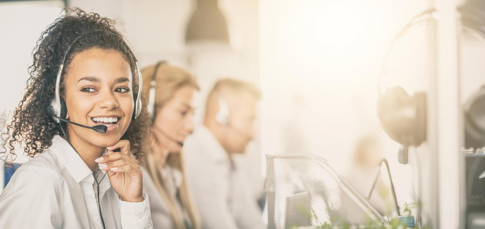 A female employee with a headset in a customer call centre