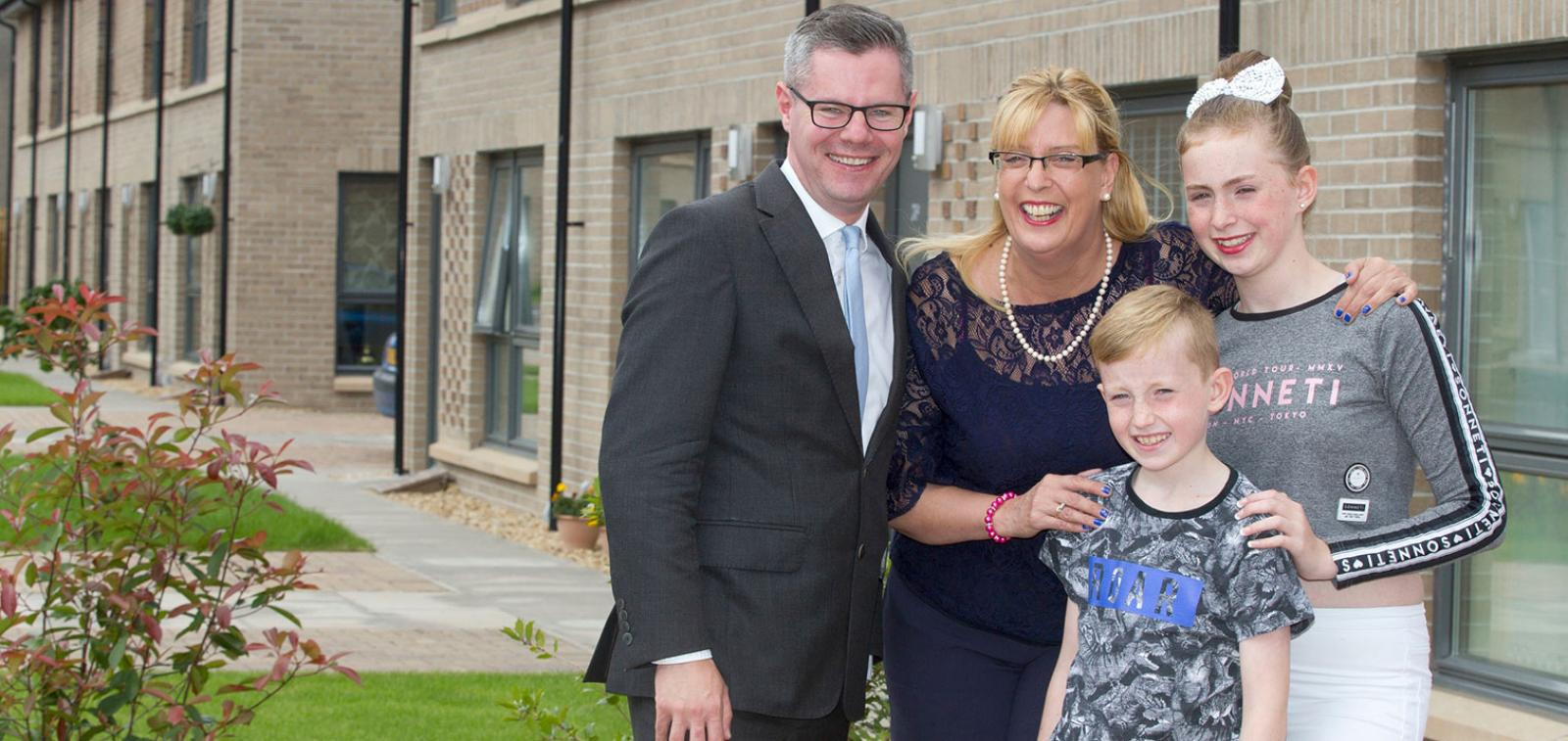 Derek Mackay MSP with new Sanctuary tenant Christine Pert, her son Rory and daughter Daisy.