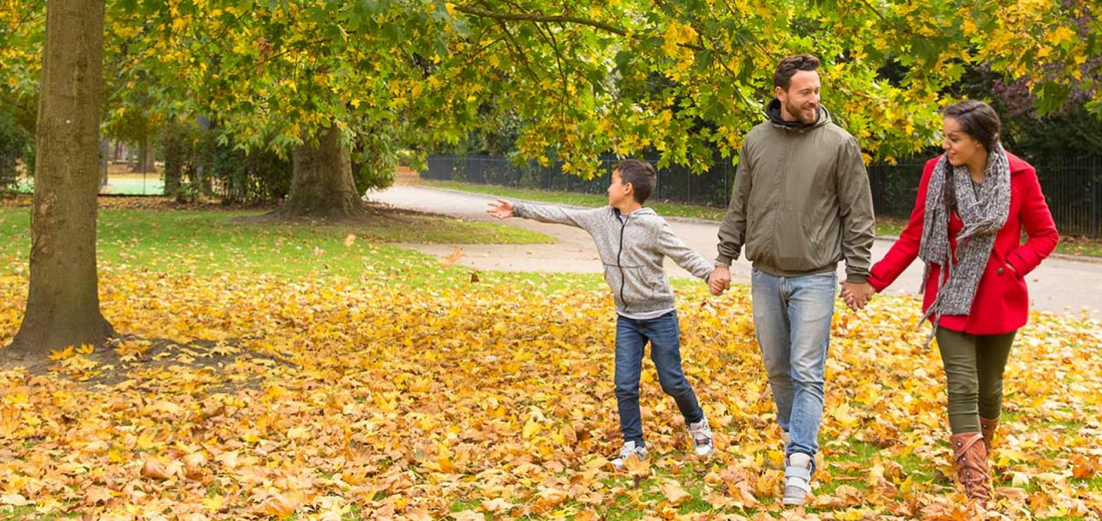 Young family walking in the autumn.