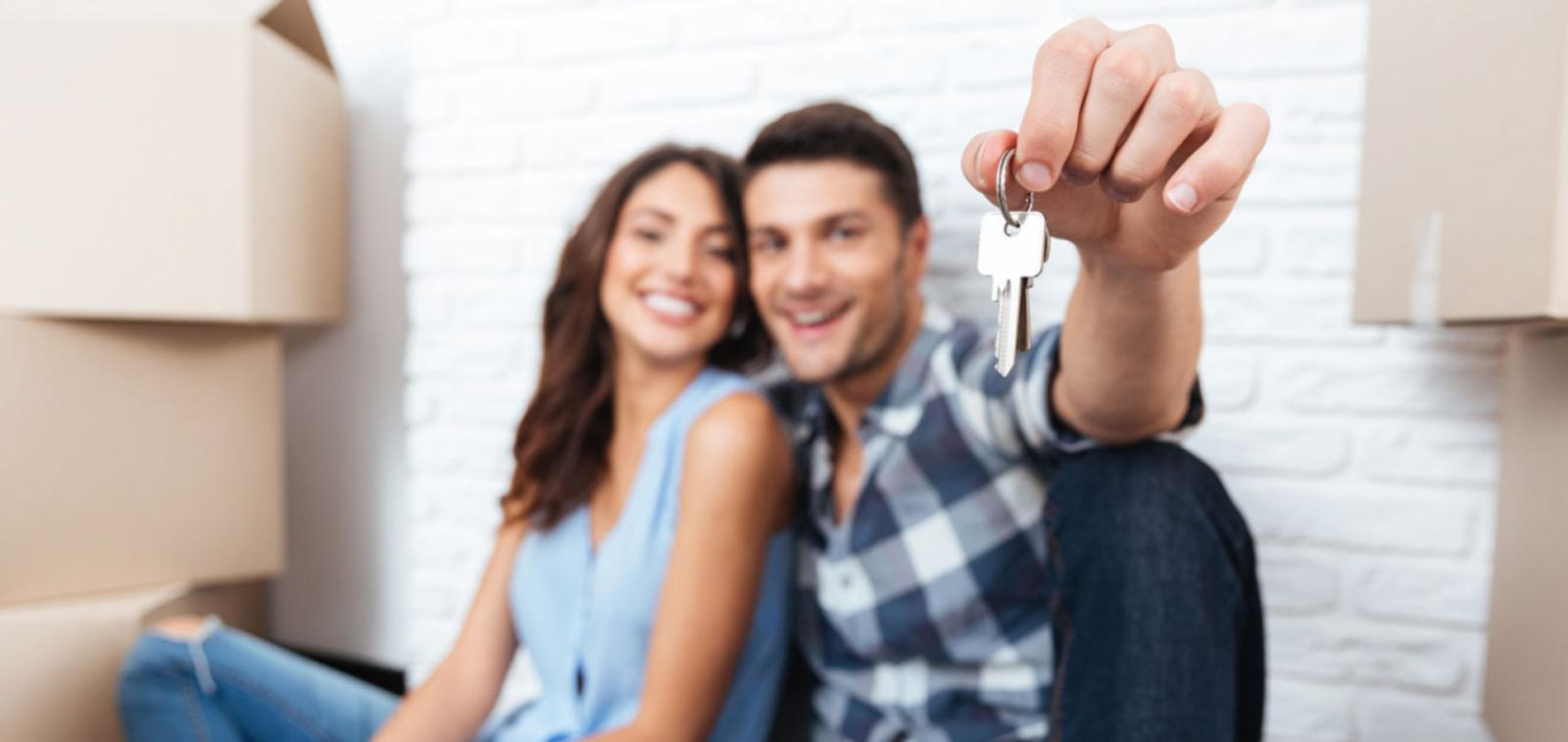 New homeowners holding their keys