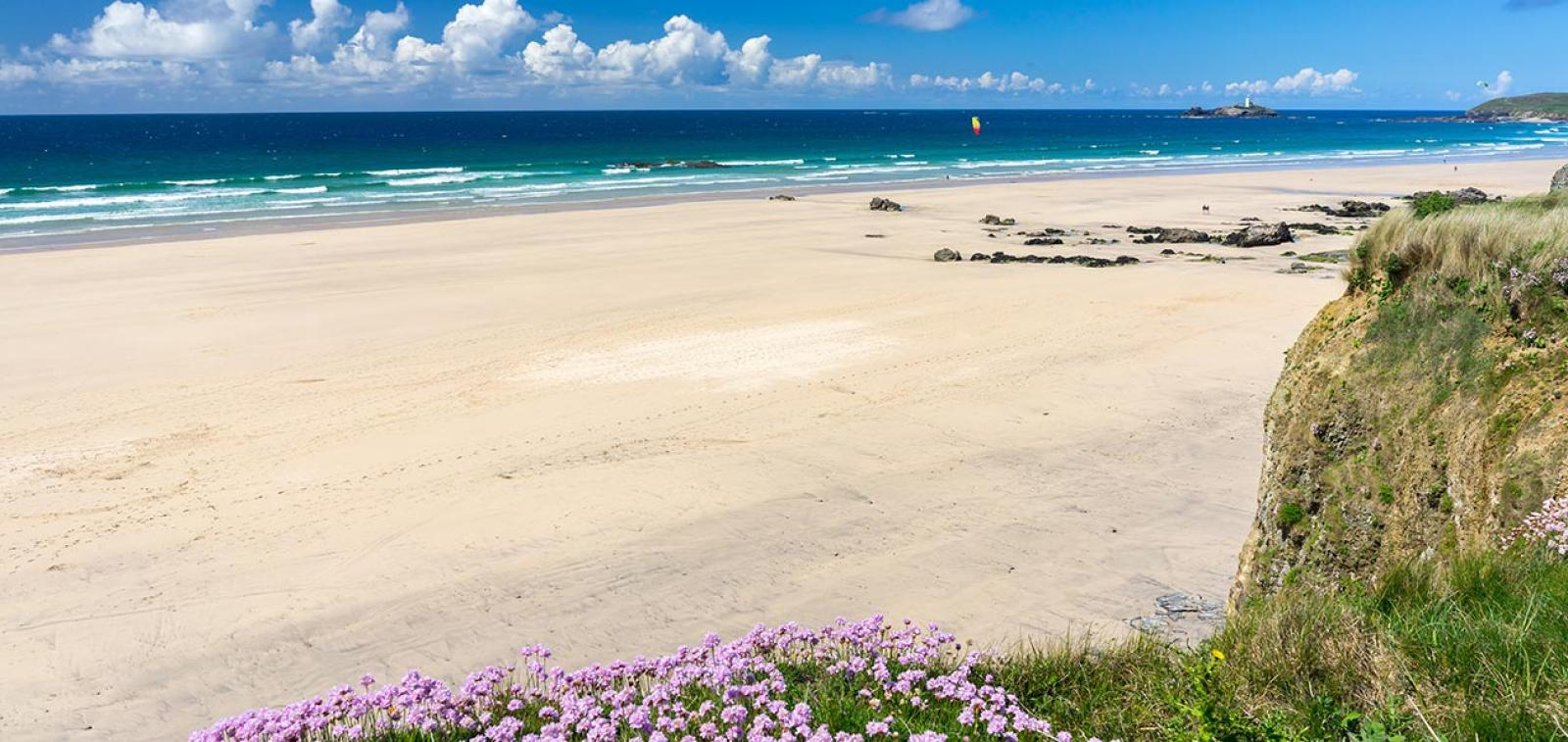 The beautiful golden sandy beach at Gwithian with Godrevy in the distance
